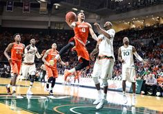Syracuse University forward Michael Gbinije (0) drives in the second half of the Syracuse-Miami game played in Coral Gables Fl., Jan. 2, 2016. Dennis Nett | dnett@syracuse.com