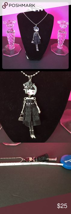 BRAND NEW DOLL NECKLACE SO Adorable, she is dressed for the town, Look at her adorable face, she is on a 14 inch chain, with the doll she is 18 inches long. The doll itself is so adorable like I said  she has silver plated arms and legs and her 👛 is silver. This doll necklace has a cute face , black hat, black lace 👗 .   She is just one of a kind, please look at all her detail. Fashin Jewlery Jewelry Necklaces