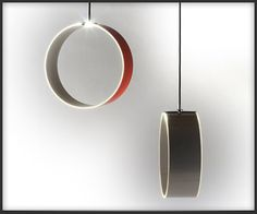 OO!2 Lighting Collection. These sleek OO!2 Circular lights from Teun Fleskens emit ambient light from the edges of the circles and can be used as hanging or tabletop lamps. Offered in acrylic or wood veneer finish.