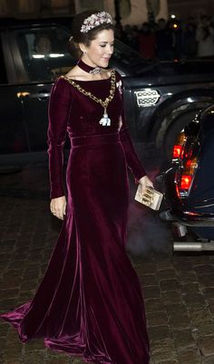 "CP Mary looking so graceful in her red velvet gown. I like the velvet ""necklace"" touch."