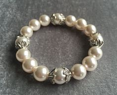 White Swarovski Pearl and Antique Silver Leaf Bracelet by DesignsbyLolaBelle on Etsy