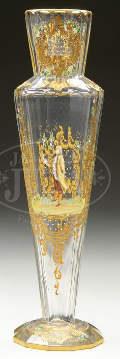 Gilt And Enamel Decorated Vase Has Faceted Clear Glass Body With Raised Gilt Scrolls Surrounding A Center Panel With A Colonial Era Gentleman Holding A Flower, Back Side Of Vase Decorated With Gilt Cartouche As Well As Enameled Pink Flowers - Attributed To Meyr's Neffe  -  James D. Julia, Inc. Auctioneers