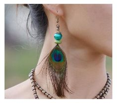 Where Style is Created. These original Peacock Feather Drop Earrings will get you out from crowd, so be bold and choose the originality. Peacock Jewelry, Peacock Earrings, Feather Jewelry, Feather Earrings, Women's Earrings, Earrings Handmade, Handmade Jewelry, Bijoux Diy, Boho Hippie