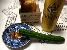 Morokyu (Cucumber with Moromi Miso) and a bottle of Beer in Japan Japanese Food, Vodka Bottle, Cucumber, Beer, Root Beer, Ale, Japanese Dishes, Solar Eclipse, Zucchini