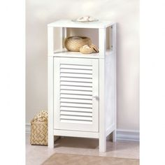 "#15130 NANTUCKET SHELF CABINET Description: Dont hide those lovely towels and soaps! This decorators dream bathroom cabinet comes complete with a storage compartment at bottom and an open shelving system on top for display or easy access. 15.8"" x 11.8"" x 33.1"" PRICE: $129.95"