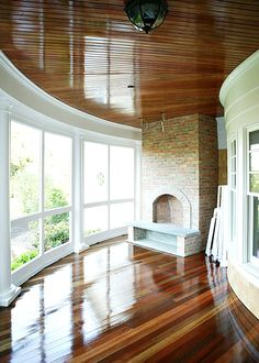 that floor!! that ceiling!! the sunroom of Michael J. Fox's $6.3 Million Southampton Home.... complete with a fireplace, but really, who would fire it up with the possibility of sparks hitting that gorgeous floor?!?!