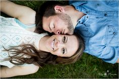 engagement session pose ideas kissing laying in the grass