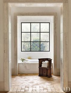 love the steel window, the marble bath, the brick floors, and the unique chair-turned-shelf