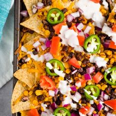 Vegan Sheet Pan Nachos made with black beans, corn, your favorite dairy-free cheese, and all the delicious toppings your heart desires! This sheet pan meal can be made in less than 15 minutes and is great for an easy dinner or a fun dish to feed a crowd. Vegan Appetizers, Vegan Dinner Recipes, Vegetarian Recipes, Breakfast Recipes, Healthy Recipes, Vegan Meals, Easy Vegan Dinner, Vegan Desserts, Soup Recipes