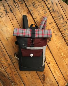 Gray, burgundy and black rolltop rucksack from canvas, checked textiles and a beer cap as a decorative button, by 'eating the goober'