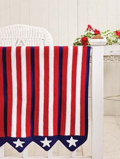 Stars & Stripes Afghan.  Crochet this patriotic showpiece of bunting stripes and stars to adorn your house with color and display your patriotism all year long. Beginners have the skills to make this afghan and they will achieve stunning results. Bunting stripes and stars add up to a patriotic showpiece.  from Talking Crochet Newsletter   from Crochet World