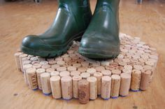 Wine corks transformed into a mudroom doormat for wet boots and shoes. Genius!