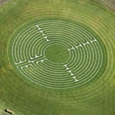 The Labyrinth symbolizes finding direction on your personal journey and reaching inner peace & harmony.