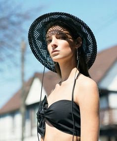 Clyde Black Koh Hat, Maryam Nassir Zadeh Black Pina Bra Top, & Pamela Love Silver Reflect Chain Hoop Earrings