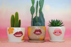"Tatiana Cardona's ceramic planters, mugs, and vases might pucker up for a kiss but their lips will never tell. The Miami-based artist, who runs the shop Female Alchemy, creates playful vessels featuring pursed lips lined in reds and pinks and minimal faces with moody expressions. ""The concept of lips was inspired by the feminist movement in the '60s-'70s where red lipstick stood as a symbol of protest. The work has since then evolved into a positive and fun way to promote femininity in a s Ceramic Planters, Ceramic Mugs, Ceramic Pottery, Scrap Material, Colossal Art, How To Line Lips, Cute Mugs, Ceramic Artists, Red Lipsticks"