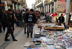 ISIS burn 10,000 books and more than 700 rare manuscripts as they destroy library in Mosul in latest attack on civilisation and culture
