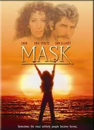 Mask: Rocky Dennis (Eric Stoltz) is a teenager with a deformed skull, trying to cope with the inevitable high-school taunts and deal with the fact that he could die at any time. Meanwhile, his long-suffering mother (Cher) begins a relationship with biker Gar (Sam Elliott).