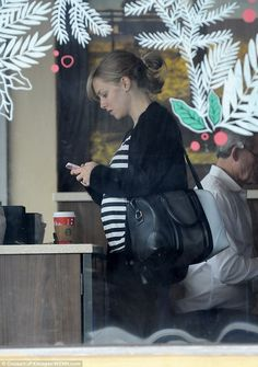 There it is: Actress Amanda Seyfried showed off her baby-bump while out in LA on Tuesday...