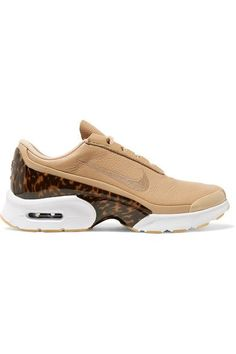 """Nike's 'Jewell LX' sneakers have 'Air Max' cushioned heels - the innovative technology is """"engineered for all-day, everyday comfort."""" This pair is made from smooth beige leather and trimmed with a molded tortoiseshell heel counter. Wear yours with frayed jeans."""