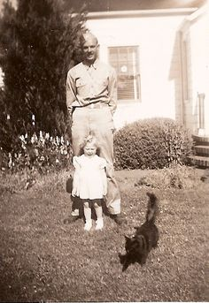 Serviceman, his daughter and their photobombing cat. ca 1943