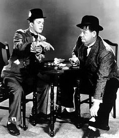 Laurel and Hardy playing cards...both cheating ☆ Stan Laurel made his stage debut at the Britannia Panopticon 1906 ☆