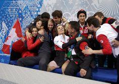 Meagan Duhamel and Eric Radford of Canada hug teammates and coach Richard Gauthier  (Team Event) #Sochi2014 #FigureSkating