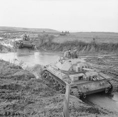 Crusader and Valentine tanks negotiate boggy ground on a training course at Linney Head in Wales, 17 December 1942