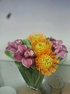 Design by mohammad ...Designer arrangement using still grass cymbidium orchids pink christian Protea