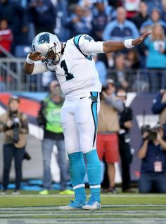 Carolina Panthers quarterback Cam Newton dabs for the crowd after scoring a…