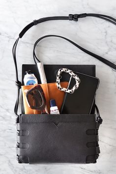 It's summer and that means we're on the move a lot. Our go-to bag for running around town and lunch dates is our cage crossbody. This compact little bag is in f What In My Bag, What's In Your Bag, Flat Lay Photography, Product Photography, Inside My Bag, Bag Organization, Organizing, What's In My Purse, Magic Bag
