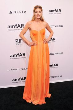 Doutzen Kroes looked beautiful in orange when she attended the amfAR Gala on Wednesday. #NYFW