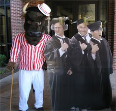 MU Family Campaign - Marshall University Images. Marco poses with some recent grads