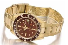 Rolex. A very rare and attractive 18K gold automatic dual time wristwatch with sweep centre seconds, date, bakelite bezel, burgundy brown coloured exclamation dial and bracelet #ChristiesWatches