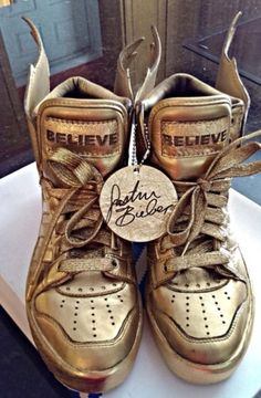 Get this look on @Wheretoget or see more #shoes #justin_bieber #gold #wings #adidas_wings #bag