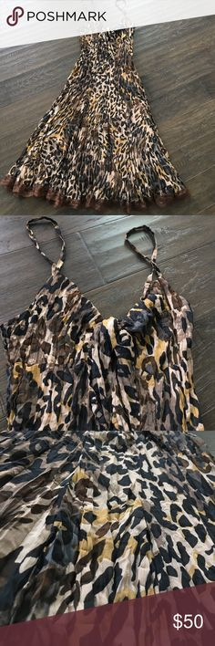 Cache Animal Print Dress Spaghetti strap animal print dress by Cache.   Straps are adjustable.  Knot tied  front. Lace trimmed.  Crinkle gold lining. Cache Dresses