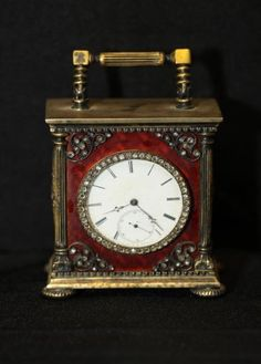 "Erik Kollin (1836-1901) Faberge carriage clock with diamond encrusted border around clock face, diamond encrusted eagle mounts on enamel side panels, marked on bottom of clock with the Faberge mark ""84"" ""EK"" in original Faberge box."