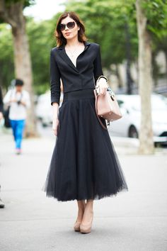 Paris Fashion Show Attendee - love the nude accessories with the black!