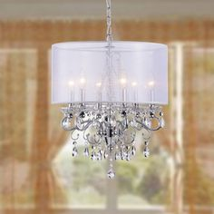 @Overstock - Allured Crystal Chandelier with White Fabric Shade - Give your home a new focal point with this attractive fabric shade chandelier. This lighting fixture is both classic and elegant.    http://www.overstock.com/Home-Garden/Allured-Crystal-Chandelier-with-White-Fabric-Shade/7538666/product.html?CID=214117  $151.99