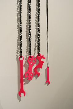 Spray painted tools attached to chains to make cool necklaces
