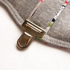 How to Install a Tongue/Press Lock on your Bag or Necessary Clutch Wallet: Includes instructions for a alternate front flap for your wallet! - Emmaline Bags: Sewing Patterns and Purse Supplies