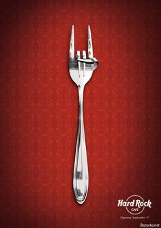 In this Hard Rock Cafe ad, the design has combined a fork - standard eating tool - with a hand symbol that is common at rock concerts. The visual language in this image is the hard rock edge for this dining experience.