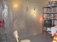 Hanging creepy blood stained plastic sheeting would give the haunted hospital/ insane asylum feel