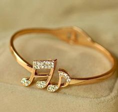 Music note ring. That's beautiful. I would accept this as an engagement ring... :P