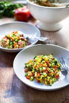 Israeli Salad made with finely chopped vegetables, fresh herbs, lemon and olive oil. Vegan and Gluten Free! | Tasty and healthy! www.feastingathome.com