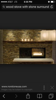 modern mantle stacked stone fireplace