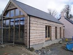 Private House Pembrokeshire Softwood cladding is used here to blend a new extension to an old Welsh cottage. This heavy duty type of wany edged boarding is very effective in a rural setting. Larch Cladding, House Cladding, Welsh Cottage, Cottage Extension, Lofts, Garden Buildings, Building A Shed, House Extensions, The Ranch