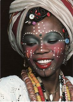 One of Fela's women....I have always admired their vibrant & fearless use of color & beads