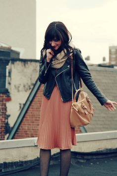 Pleated skirt, biker jacket, knit scarf. La vie en coral.