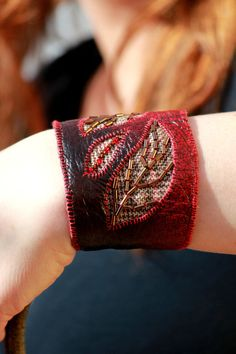 Autumn Love Bracelet, leather and tweed hand cuff bracelet,  hand stitched leather wrist cuff. £35.00, via Etsy.