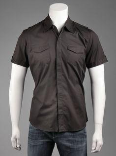 7 Diamonds® Men's Victory Shirt in Black.    Edgy meets classic button-down style in this basic black short-sleeve shirt for men. Features a pointed collar, front flap pockets and a slim fit that stops mid-hip. Create the perfect rock-star look when you pair with dark wash jeans and biker boots!